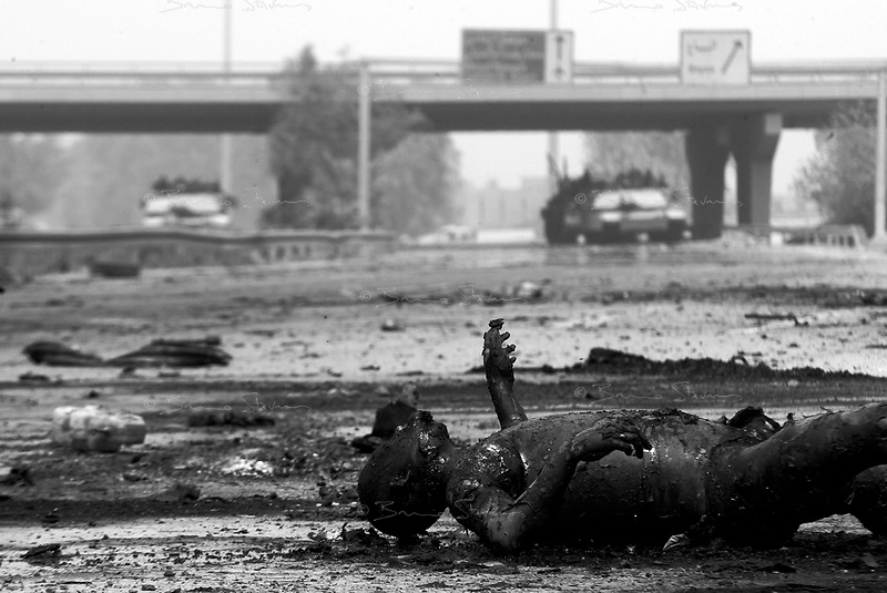 Baghdad, Iraq, April 9, 2003.Jamieh, southern outskirts of Baghdad, a short distance away from US Abrams tanks, torn vehicles and charred bodies on the Hilla road bear witness of the violence of the fight for the city.