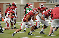 NWA Democrat-Gazette/ANDY SHUPE<br /> Arkansas tight end Hunter Henry (center) blocks Tuesday, Aug. 18, 2015, during practice at the university's practice field in Fayetteville.
