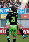 Nederland, Zwolle, 11 november  2012.Eredivisie.Seizoen 2012-2013.PEC-Zwolle-Ajax.Viktor Fischer van Ajax juicht na het scoren van de 0-3 en wordt gefeliciteerd door Derk Boerrigter