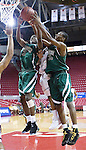 The Gazette Surrattsville High School senior guard Ifadeyo Olasupo (left) gets the offensive rebound with team mate Jamahl Brown during the second quarter of the Maryland state 1A finals against Snow Hill High School at Comcast Center in College Park on Saturday afternoon.
