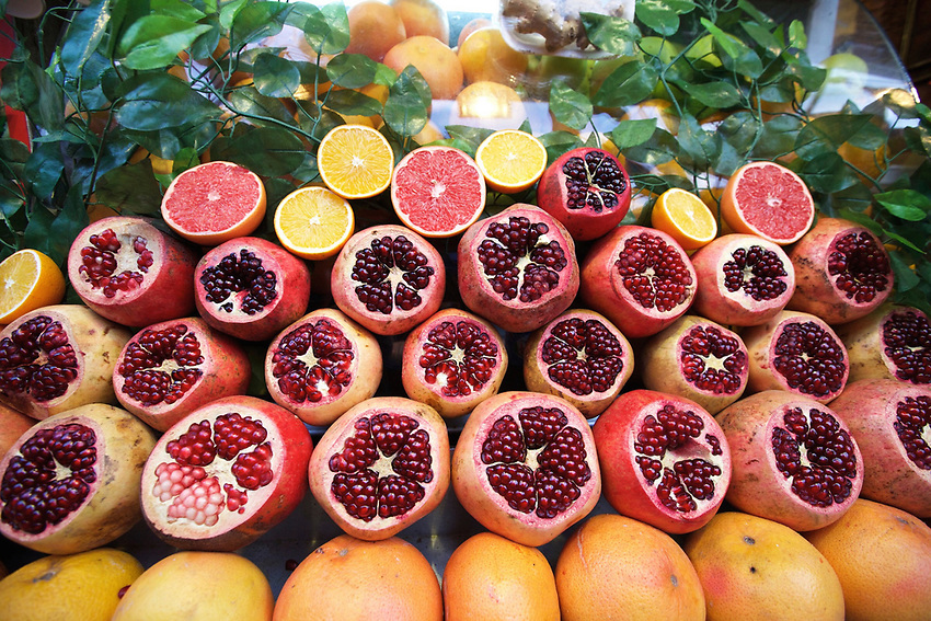 ISTANBUL, TURKEY - December 2, 2015: Fruits on display at a juice stand in Beyoglu, near Galata Tower.<br /> <br /> CREDIT: Clay Williams.<br /> <br /> &copy; Clay Williams / claywilliamsphoto.com