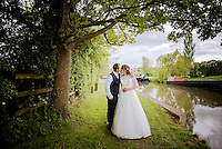 Husband and Wife kissing by the Grand Union Canal, Dodmoor, Northamptonshire.