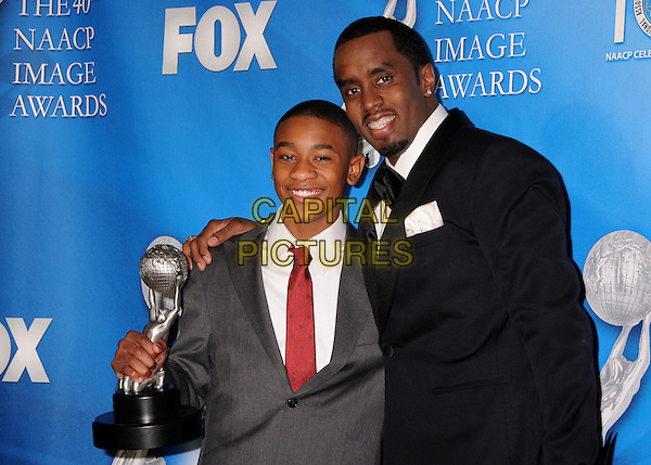"JUSTIN MARTIN & SEAN ""DIDDY"" COMBS.40th Annual NAACP Image Awards - Press Room at the Shrine Auditorium, Los Angeles, California, USA..February 12th, 2009.half length p puff daddy black suit jacket award trophy goatee facial hair grey gray red tie .CAP/ADM/BP.©Byron Purvis/AdMedia/Capital Pictures."