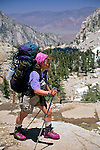 Female backpacker on the Mount Whitney Trail, Inyo National Forest, Eastern Sierra, California