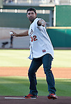PGA golfer Padraig Harrington throws out the first pitch during the Reno Aces and Sacramento River Cats game on Monday night July 30, 2012 at Aces Ballpark in Reno, Nevada.