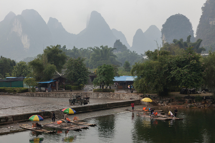 Lush karst peaks dominate the background of the Yulong River valley near Yangshuo.