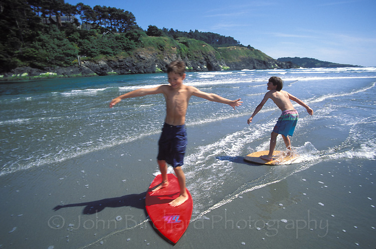 Young Boys skim Boarding at Big River beach, Mendocino California
