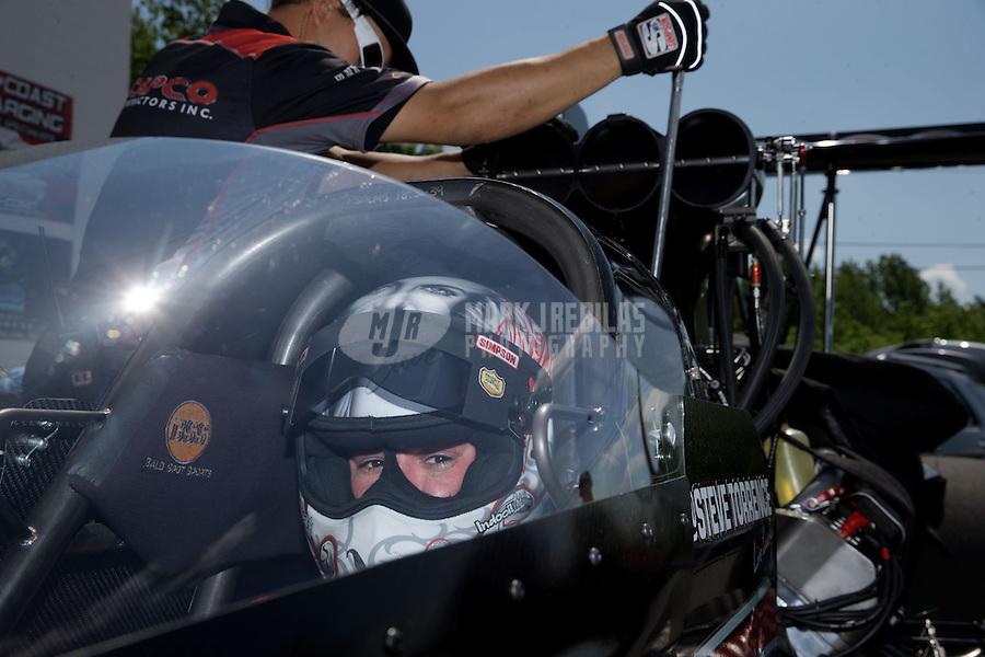 Jun. 2, 2013; Englishtown, NJ, USA: NHRA top fuel dragster driver Steve Torrence during the Summer Nationals at Raceway Park. Mandatory Credit: Mark J. Rebilas-