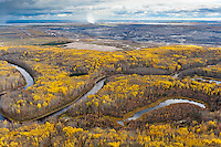 "MacKay River, Boreal Forest, and Tar Mine                                                      Northern Alberta. Canada. 2010.  The Boreal Forests and wetlands that surround the Tar Sands are the most carbon rich terrestrial ecosystem on the planet, holding almost twice as much carbon per acre as tropical rainforests. Referred to by the Tar Sands industry as ""overburden,"" these forests are scraped off and the wetlands dredged, to be replaced by tar mines like this whihc produce significantly more carbon that traditional oil extraction.     Nikon D3, Nikkor 24-70  f2.8. Shot at 34, iso 800, 1/1250 at f4. Alberta Tar Sands, Northern Alberta, Canada."