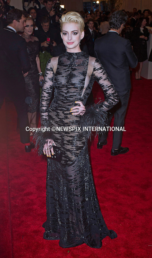 """ANNE HATHAWAY.attends the Costume Institute Gala at the Metropolitan Museum of Art, New York.The event is considered the Oscars of the Fashion world_06/05/2013.Mandatory credit photo:©Dias/NEWSPIX INTERNATIONAL..**ALL FEES PAYABLE TO: """"NEWSPIX INTERNATIONAL""""**..PHOTO CREDIT MANDATORY!!: NEWSPIX INTERNATIONAL(Failure to credit will incur a surcharge of 100% of reproduction fees)..IMMEDIATE CONFIRMATION OF USAGE REQUIRED:.Newspix International, 31 Chinnery Hill, Bishop's Stortford, ENGLAND CM23 3PS.Tel:+441279 324672  ; Fax: +441279656877.Mobile:  0777568 1153.e-mail: info@newspixinternational.co.uk"""