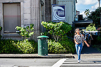 A young local teenager crosses the street near the Pacific Tsunami Museum in downtown Hilo, Big Island of Hawai'i.
