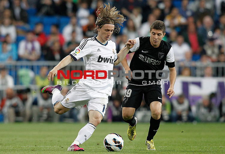 08.05.2013, Santiago Bernabéu, Madrid, LIGA.  Real Madrid vs Malaga, im Bild   Real Madrid's Luka Modric (l) and Malaga's Francisco Portillo during La Liga match.May 08,2013. Foto © nph / Acero)