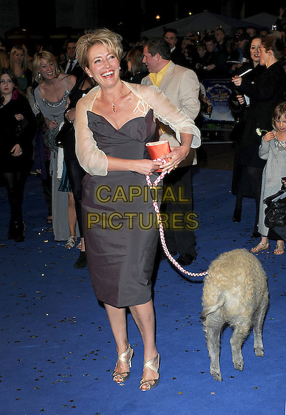 """EMMA THOMPSON.attending The World Premiere of """"Nanny McPhee & The Big Bang"""", Odeon West End, London, England, UK, .24th March 2010..arrivals full length pig on lead leash pet animal funny brown grey gray strapless dress cream gold shrug smiling red clutch bag sandals .CAP/BEL.©Tom Belcher/Capital Pictures."""