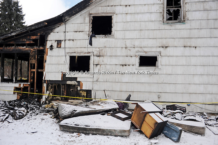 Personal artifacts are seen covered in snow outside a house torched by an arsonist on White Pigeon Street in Constantine, Michigan on December 22, 2010. With job loss and factory closings, many have left Michigan in favor of jobs and a better economic climate elsewhere as reflected in the recent 2010 census which shows Michigan was the only state to lose population in the last decade.