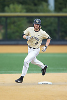Johnny Aiello (2) of the Wake Forest Demon Deacons rounds second base after hitting a home run against the Georgia Tech Yellow Jackets at David F. Couch Ballpark on March 26, 2017 in  Winston-Salem, North Carolina.  The Demon Deacons defeated the Yellow Jackets 8-4.  (Brian Westerholt/Four Seam Images)
