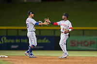 Scottsdale Scorpions infielders Andres Gimenez (13) and Shed Long (6) celebrate a victory after an Arizona Fall League game against the Mesa Solar Sox at Sloan Park on October 10, 2018 in Mesa, Arizona. Scottsdale defeated Mesa 10-3. (Zachary Lucy/Four Seam Images)