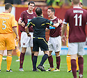 HEARTS' IAN BLACK ARGUES WITH REFEREE STEVIE O'REILLY AFTER BEING SENT OFF