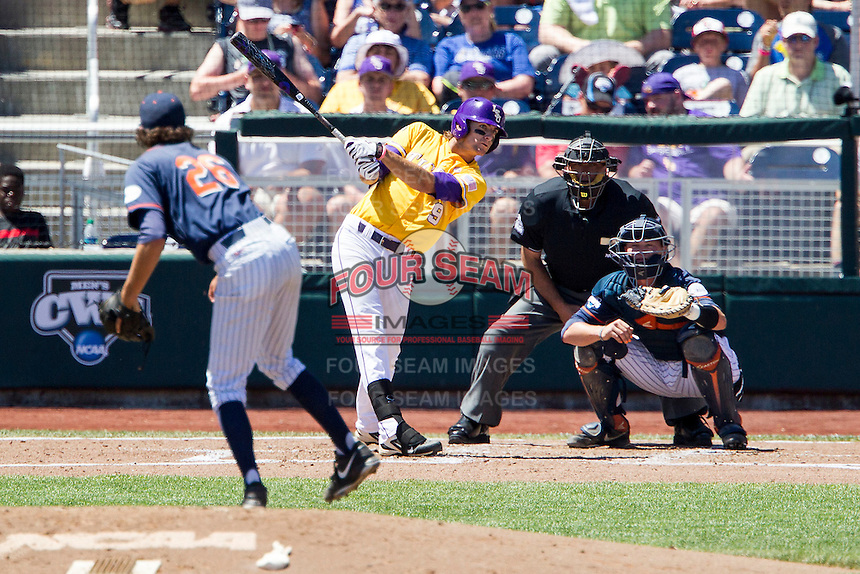 LSU Tigers outfielder Mark Laird (9) swings the bat during the NCAA College baseball World Series against the Cal State Fullerton on June 16, 2015 at TD Ameritrade Park in Omaha, Nebraska. LSU defeated Fullerton 5-3. (Andrew Woolley/Four Seam Images)