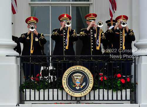 Buglers on the South Portico of the White House following the ceremony where United States President Barack Obama welcomed President Felipe Calderón of Mexico for a State Visit on Wednesday, May 19, 2010..Credit: Ron Sachs / CNP