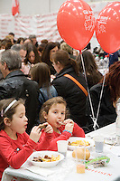 "Switzerland. Canton Ticino. Bellinzona. Two young girls  eats food during Easter sunday at Officine FFS. Stabilimento Industriale SBB CFF FFS Cargo. Railway workers on strike. Building's occupation. Red balloons: "" Giù le mani dall'Officina di Bellinzona"". © 2008 Didier Ruef"