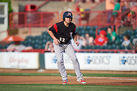 Richmond Flying Squirrels third baseman Christian Arroyo (22) leads off first during a game against the Erie SeaWolves on May 27, 2016 at Jerry Uht Park in Erie, Pennsylvania.  Richmond defeated Erie 7-6.  (Mike Janes/Four Seam Images)