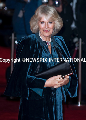 """Prince Charles and Camilla.Their Royal Highnesses The Prince of Wales and The Duchess of Conwall attend the 2009 Royal film performance and world premiere of The Lovely Bones at the Odeon Leicester Square_London, 24/11/2009.Mandatory Photo Credit: ©Dias/Newspix International..**ALL FEES PAYABLE TO: """"NEWSPIX INTERNATIONAL""""**..PHOTO CREDIT MANDATORY!!: NEWSPIX INTERNATIONAL(Failure to credit will incur a surcharge of 100% of reproduction fees)..IMMEDIATE CONFIRMATION OF USAGE REQUIRED:.Newspix International, 31 Chinnery Hill, Bishop's Stortford, ENGLAND CM23 3PS.Tel:+441279 324672  ; Fax: +441279656877.Mobile:  0777568 1153.e-mail: info@newspixinternational.co.uk"""