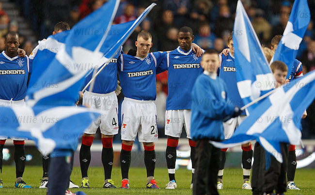 Rangers players have a minutes silence in memory of Gary Speed