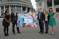NZ Shark Alliance Youth Ambassador Taylor Finderup hands conservation Minister Nick Smith and Primary Industries Minister Nathan Guy some of the 78,000 pledges made in support of a ban on the practice of shark finning. Parliament Buildings, Wellington, New Zealand on Thursday, 5 December 2013. Pictured, from left: Katrina Subedar (Forest and Bird marine conservationist), Nathan Guy, Nick Smith, Taylor Finderup and Milena Palka (WWF marine species advocate). Photo: Dave Lintott / lintottphoto.co.nz