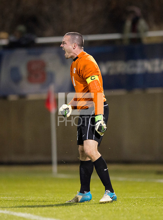 Scott Goodwin (1) of North Carolina reacts to making a save on a penalty kick during the game at the Maryland SoccerPlex in Germantown, MD. North Carolina defeated Virginia on penalty kicks after playing to a 0-0 tie in regulation time.  With the win the Tarheels advanced to the finals of the ACC men's soccer tournament.