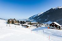 Austria, Vorarlberg, Kleinwalsertal, Hirschegg: ski run and Allgaeu Alps with summit Nebelhorn | Oesterreich, Vorarlberg, Kleinwalsertal, Hirschegg: Skipiste oberhalb des Ortszentrums vor den Allgaeuer Alpen mit Nebelhorn