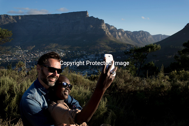 A couple has a picnic at signal hill outside Cape Town, South Africa. Cape Town has become one of the worlds must see cities, with its natural beauty, beautiful weather and reasonable priced restaurants. (Photo by: Per-Anders Pettersson)