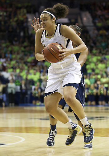 March 04, 2013:  Notre Dame guard Kayla McBride (21) goes up for a shot during NCAA Basketball game action between the Notre Dame Fighting Irish and the Connecticut Huskies at Purcell Pavilion at the Joyce Center in South Bend, Indiana.  Notre Dame defeated Connecticut 96-87 in triple overtime.