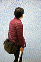 "A man looks at a wall of 100,000 Slime characters in Shinjuku Station on February 26, 2015. 100,000 Blue Slime from the game of Dragon Quest are displayed in bubble-wrap in a corridor of Shinjuku Station. The wall was created to promote the newest video game ""Dragon Quest Heroes: The Dark Dragon and the World Tree Castle"" for Playstation 3 and 4. Passersby can pop the Slimes and the goal of for all 100,000 bubbles to have been burst by the end of the campaign. There are special characters such as metal Slimes and Rockbombs hidden along the wall and the installation is accompanied by background music from the game. The promotion runs from February 23rd to March 1st in Tokyo. (Photo by Rodrigo Reyes Marin/AFLO)"