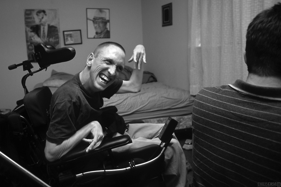 Sean Pevnser celebrates after completing an application for a summer fellowship, under the watchful eye of John Wayne.<br /> <br /> Sean Pevsner was born with severe cerebral palsy. He is in his final year of law school at the University of Texas.