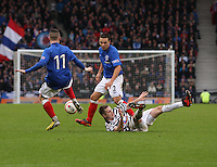 Ian Watt lands on the ground after the tackle from Barrie McKay as Chris Hegarty watches in the Queen's Park v Rangers Irn-Bru Scottish League Division Three match played at Hampden Park, Glasgow on 29.12.12.