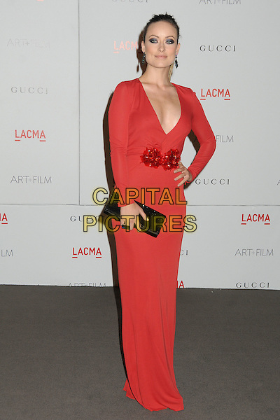 Olivia Wilde.The Inaugural Art and Film Gala held at LACMA in Los Angeles, California, USA..November 5th, 2011.full length dress red low cut neckline cleavage black clutch bag corsage hand on hip.CAP/ADM/BP.©Byron Purvis/AdMedia/Capital Pictures.