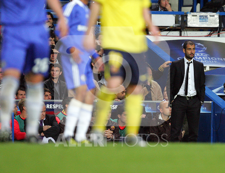 A dejected Josep (Pep) Guardiola watches from the sideline as Barcelona go 1-0 down during the UEFA Champions League Semi Final Second Leg match between Chelsea and Barcelona at Stamford Bridge on May 6, 2009 in London, England.