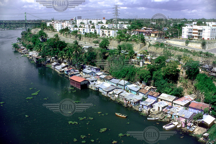 Riverside shacks and luxury housing.