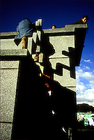 Children play on an above-ground vault in the northern Guatemalan town of Xela (Quetzaltenango).