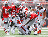 Ohio State Buckeyes wide receiver Parris Campbell (21) fights for yardage as Oregon State Beavers cornerback Dwayne Williams (4) and Oregon State Beavers linebacker Kee Whetzel (7) make the tackle during the first quarter of a NCAA college football game between the Ohio State Buckeyes and the Oregon State Beavers on Saturday, September 1, 2018 at Ohio Stadium in Columbus, Ohio. [Joshua A. Bickel/Dispatch]