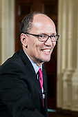 United States Secretary of Labor Thomas Perez greets attendees at an event in the East Room of the White House in Washington, D.C. on March 13, 2014. Before signing a memorandum, the president explained that overtime rules have eroded for salaried workers, who may put in more than a 40-hour workweek without earning overtime and in some cases may make less than minimum wage. <br /> Credit: T.J. Kirkpatrick / Pool via CNP