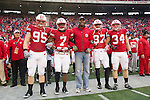 Wisconsin Badgers honorary captain Al Toon, center, lines up with captains Patrick Butrym (95), Aaron Henry (7), Nick Toon (87), and Bradie Ewing (34) during an NCAA Big Ten Conference college football game against the Penn State Nittany Lions on November 26, 2011 in Madison, Wisconsin. The Badgers won 45-7. (Photo by David Stluka)