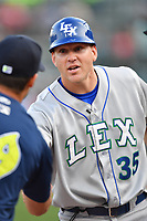 Manager Scott Thorman (35) of the Lexington Legends meets with manager Jose Leger (19) of the Columbia Fireflies before a game on Friday, April 21, 2017, at Spirit Communications Park in Columbia, South Carolina. Columbia won, 5-0. (Tom Priddy/Four Seam Images)