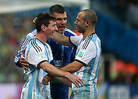 Lionel Messi of Argentina celebrates with Javier Mascherano after winning the penalty shootout