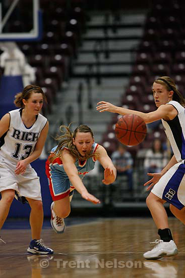 Richfield - Piute's Kandice Gleave dives for the loose ball. At left is Rich's Brittani Groll, right is Rich's Allie Eastman. Rich defeats Piute 57-43 in the 1A State Championship game, high school girls basketball at the Sevier Valley Center, Saturday, February 16, 2008.