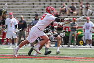 College Park, MD - May 14, 2017: Maryland Terrapins Austin Henningsen (18) reaches for the ball during the NCAA first round game between Bryant and Maryland at  Capital One Field at Maryland Stadium in College Park, MD.  (Photo by Elliott Brown/Media Images International)