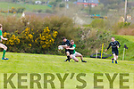 Iveragh Eagles Johny O'Shea on a run but is taken down by Dunmanways Johnny O'Sullivan.