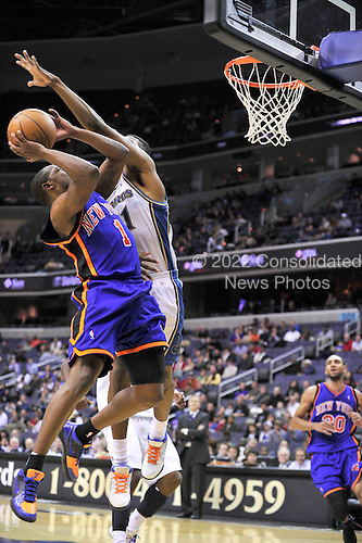 Washington, DC - January 30, 2010 -- New York Knicks guard Chris Duhon (1) tries to shoot around Washington Wizards guard Nick Young (1) in second quarter action at the Verizon Center in Washington, D.C. on Saturday, January 30, 2010..Credit: Ron Sachs / CNP.(RESTRICTION: NO New York or New Jersey Newspapers or newspapers within a 75 mile radius of New York City)