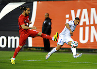 Washington, D.C.- May 29, 2014. Honduras defender Emilio Izaguirre goes against Turkey defender Tarik Camdal.  Turkey defeated Honduras 2-0 during an international friendly game at RFK Stadium.