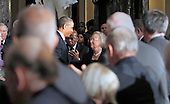 United States President Barack Obama, left, speaks to Tom Foley's wife Heather, right, during a memorial service honoring former Speaker of the U.S. House Thomas S. Foley (Democrat of Washington) in the U.S. Capitol in Washington, D.C. on October 29, 2013.   Foley represented Washington's 5th Congressional District was the 57th Speaker of the US House of Representatives from 1989 to 1995. He later served as US Ambassador to Japan from 1997 to 2001. U.S. Representative John Lewis (Democrat of Georgia) is seen between the President and Mrs. Foley.<br /> Credit: Aude Guerrucci / Pool via CNP